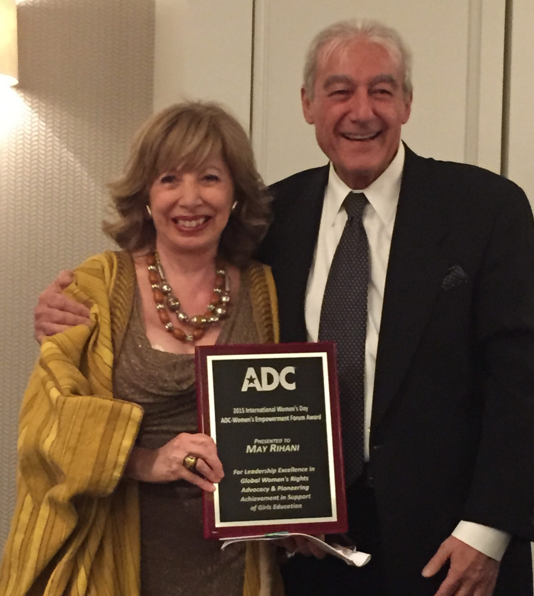 Receiving her award from Dr. Safa Rifka, ADC Board chair